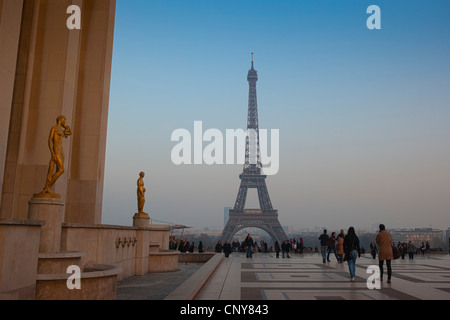 Visitors view the Eiffel Tower from the Esplanade du Trocadero - Stock Photo