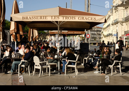 Outdoor cafe, brasserie in the Place de la Comedie in the centre of Montpellier, southern France. - Stock Photo