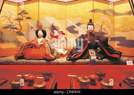 Japan Nagoya. Tokugawa Art Museum. Hina dolls, made 'washi, traditional Japanese paper, dressed in elegant refined, - Stock Photo