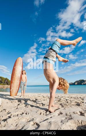 Spain, Mallorca, Children playing on beach - Stock Photo