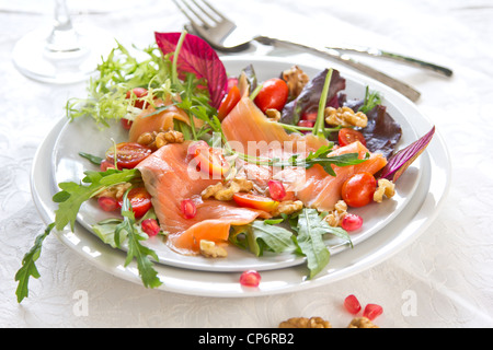 Smoked salmon with pomegranate and walnut salad - Stock Photo