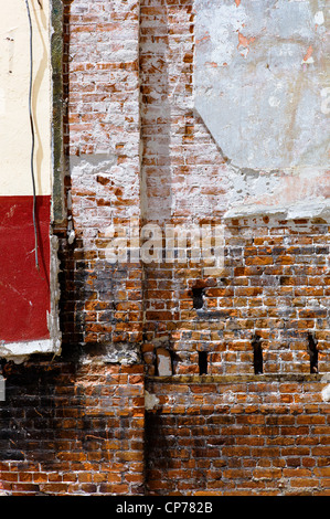Interior walls and structure of the historic Unique Theater are exposed in partial decay, Salida, Colorado, USA - Stock Photo