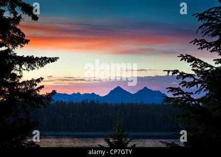 Scenic sunset view of Bartlett Cove, Glacier Bay National Park & Preserve, Southeast Alaska, Summer - Stock Photo