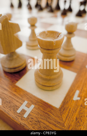 chess pieces on the chessboard, rook in the forefront - Stock Photo