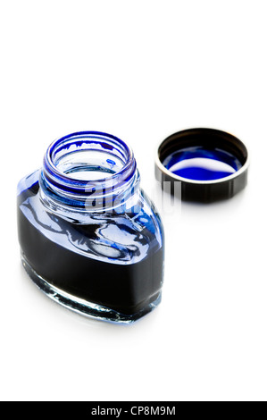 an open bottle of blue writing ink isolated on a white background - Stock Photo