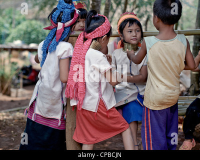 Long neck (Kayan) hill tribe children of Northern Thailand. Rural Thailand people S.E. Asia - Stock Photo