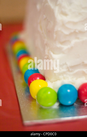 Colourful Gumballs on Child's Birthday Cake - Stock Photo