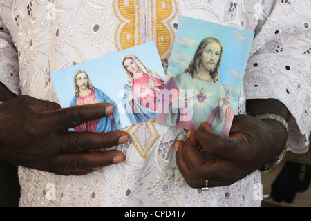 Religious images of Christ and Mary, Lome, Togo, West Africa, Africa - Stock Photo