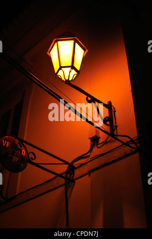 Street  light at night with old sign, Loule, Portugal - Stock Photo