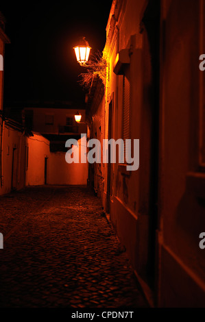 Street at night with old-fashioned lamps, Loule, Portugal - Stock Photo
