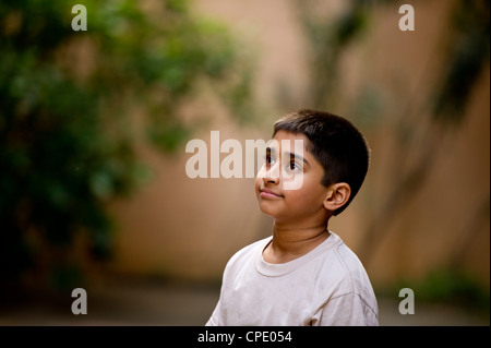 an young handsome Indian kid day dreaming - Stock Photo