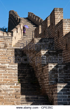 Person descending stairs, Great Wall of China, Huanghua Cheng (Yellow Flower), Ming dynasty, Jiuduhe, Huairou, China, - Stock Photo