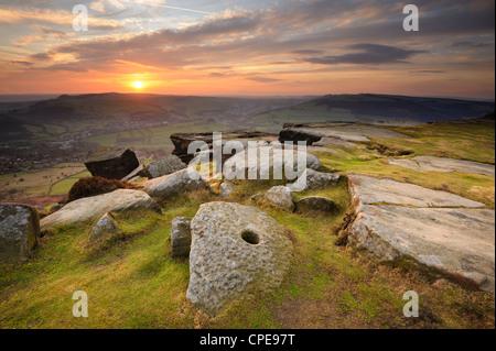 Sunset over millstones, Froggatt and Curbar Edge, Peak District National Park, Derbyshire, England, United Kingdom, - Stock Photo