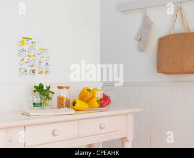 Bell Peppers, Herbs And Jar On Table - Stock Photo