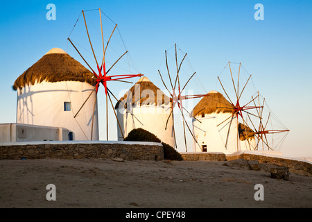 The historic windmills at Mykonos in the early morning sun - Stock Photo