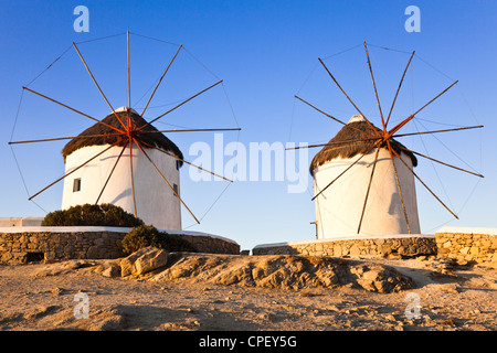 Tow of the five historic windmills at Mykonos in the early morning sun - Stock Photo
