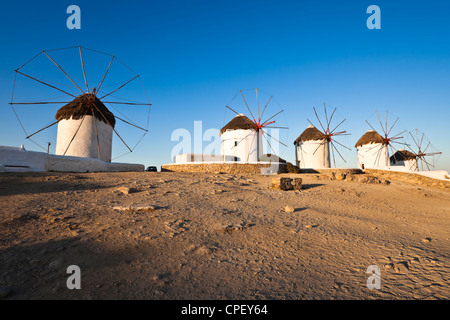 The five historic windmills at Mykonos in the early morning sun - Stock Photo