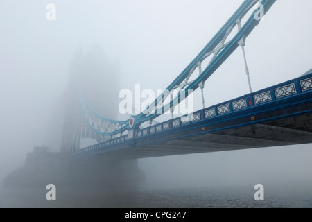 England, London, Southwark, Tower Bridge and River Thames in the Fog - Stock Photo