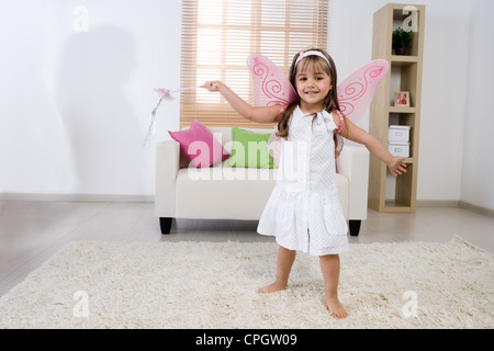 Girl with fairy wings, smiling - Stockfoto