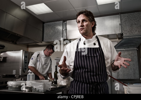 Chefs in their kitchen - Stock Photo