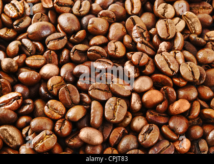 Fried coffee beans - on whole background - Stock Photo
