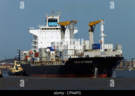 The container ship 'Maersk Nottingham' leaving Tilbury docks, the river Thames, London. - Stock Photo
