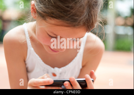 Girl playing video game - Stock Photo