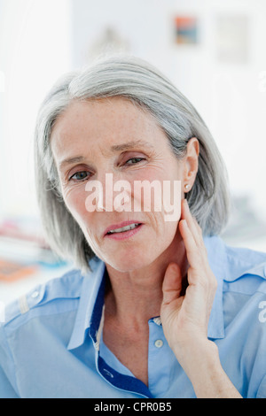 ELDERLY PERSON WITH A TOOTHACHE - Stock Photo