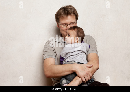 Father holding baby son - Stock Photo