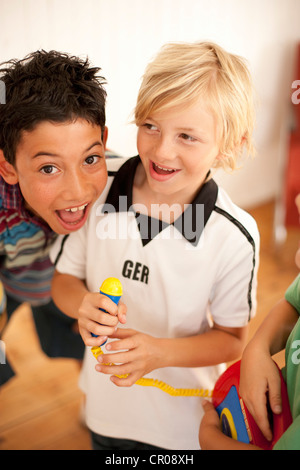 Boys playing together indoors - Stock Photo