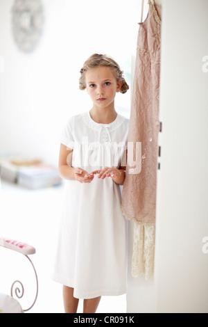 Girl walking in hallway - Stock Photo
