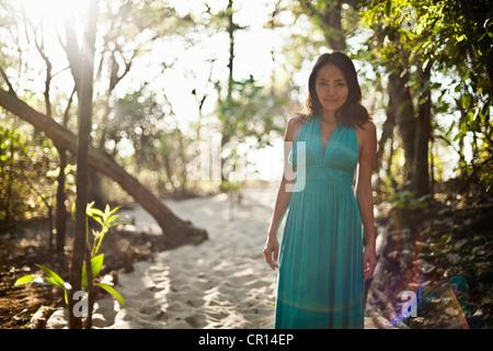 Woman walking in sandy forest - Stock Photo
