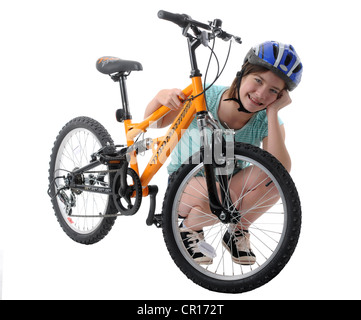 Girl and bicycle on white background - Stock Photo