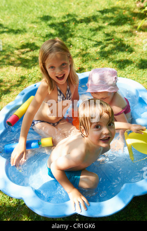 Children playing in wading pool - Stock Photo