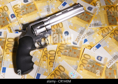 Handgun and 200 Euro bills - Stock Photo