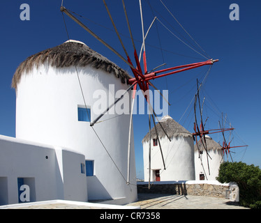 Mykonos traditional windmills, now converted to holiday homes, the Cyclades Islands, Aegean Sea, Greece - Stock Photo