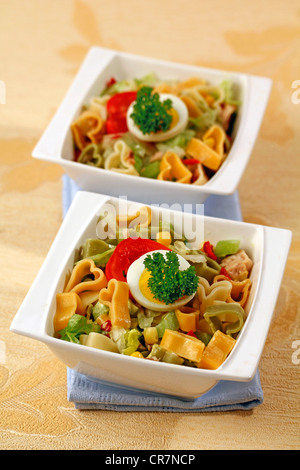 Heart shaped pasta in salad. Recipe available - Stock Photo