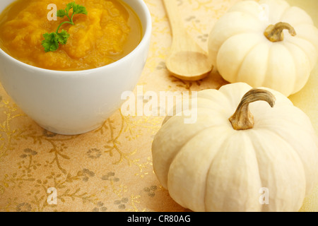 Two Pumpkins with Pumpkin Soup - Stockfoto