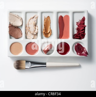 Artists palette with make up and brush - Stock Photo