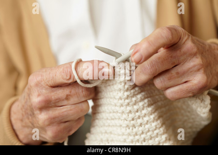 Senior woman knitting, close up - Stock Photo