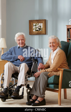 Senior couple, man in wheelchair, portrait - Stock Photo
