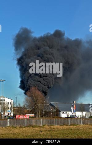 Smoke cloud from the burning Sky Bowling Center in Dachau, near Munich, Bavaria, Germany, Europe - Stock Photo