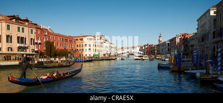 Canal Grande with boats, gondolas and the Rialto Bridge, Venice, Veneto, Italy, Europe - Stock Photo