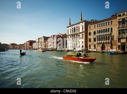 Canal Grande with boats and gondolas near the Rialto Bridge, Venice, Veneto, Italy, Europe - Stock Photo