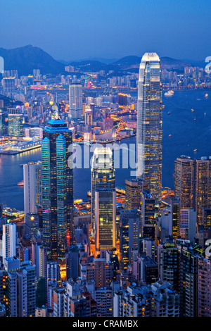 Some of Hong Kong's tallest buildings, including IFC2, seen from The Peak of Hong Kong Island at twilight. - Stock Photo