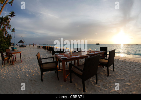 Laid table on an ideal beach, Irufushi Island, Noonu Atoll, Maldives, Indian Ocean - Stock Photo