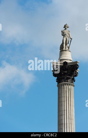 Nelsons column monument in Trafalgar Square against blue sky. London, England - Stock Photo