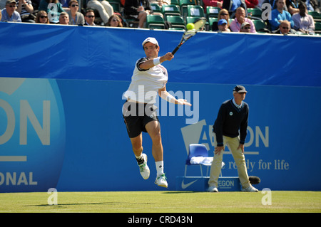 Male tennis player Jamie Baker in action at Eastbourne Aegon International Tournament 2012 - Stock Photo