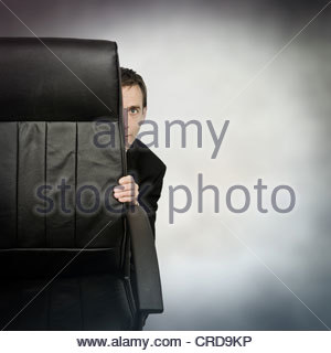 hiding businessman - Stock Photo