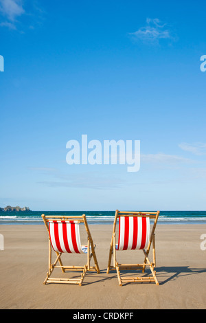 Two empty deck chairs on the beach, Camaret-sur-Mer, Finistere, Brittany, France, Europe - Stock Photo